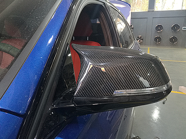 宝马3系M运动型改装声浪四出排气与碳纤MP后唇高清图片
